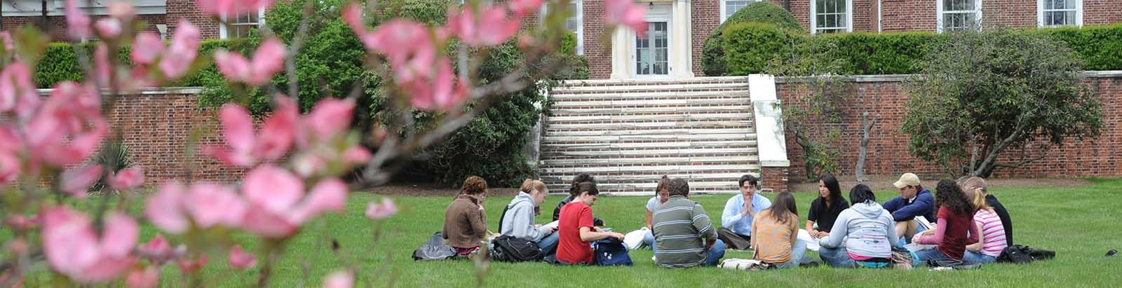 GMercyU students enjoy class outside in front of Assumption Hall, childhood home of the real James Bond.